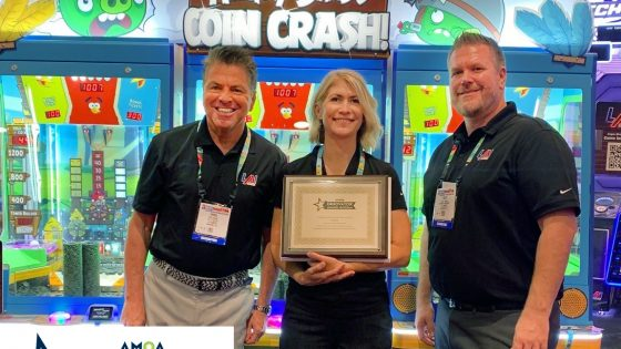 LAI Games staff in front of Angry Birds Coin Crash with Innovator Award